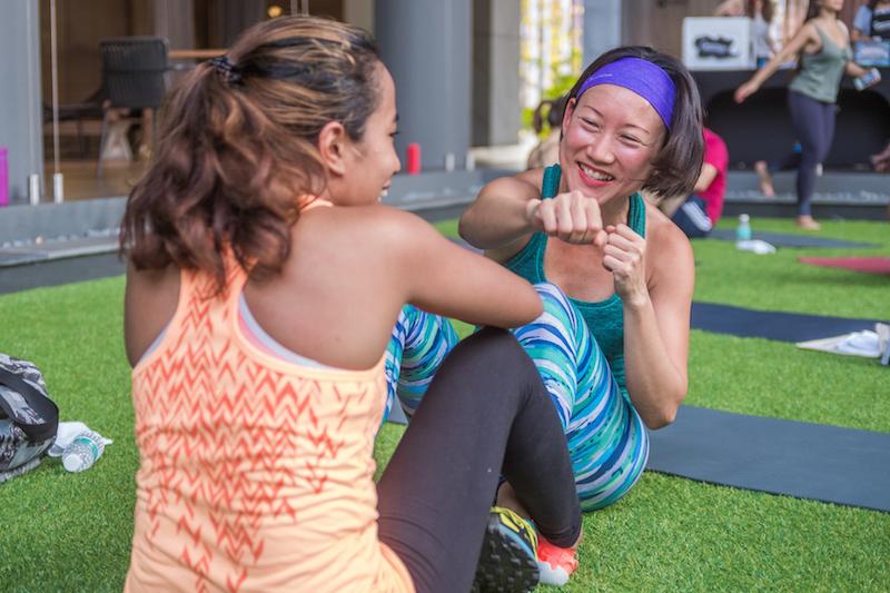 sweatbuddy workout sit up high five